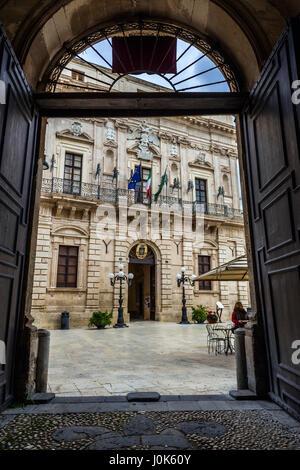 Vermexio Palace, current Town Hall (Palazzo del Vermexio) at Cathedral Square (Piazza del Duomo) on Ortygia island, - Stock Photo