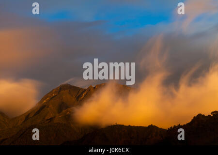 Colorful clouds at sunset in Volcan Baru National Park, Chiriqui province, Republic of Panama. - Stock Photo
