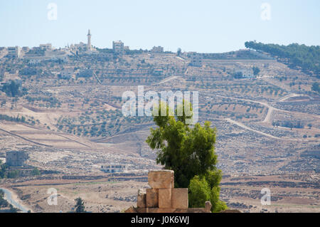 The skyline of modern Jerash, the Gerasa of Antiquity, one of the largest and most well preserved sites of Roman - Stock Photo