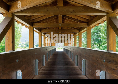 Sentiero della Valtellina, bicycle path along the Adda river iat summer. Wooden bridge - Stock Photo