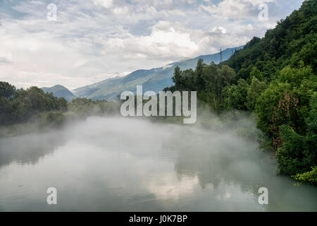 Sentiero della Valtellina, bicycle path along the Adda river iat summer. Mist - Stock Photo