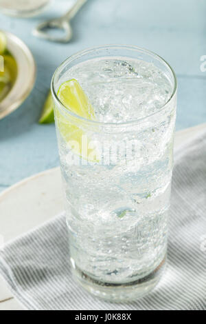 Refreshing Hard Sparkling Water with a Lime Garnish - Stock Photo