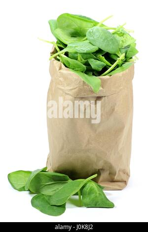 brown paper bag background flwers fresh spinach in a paper bag isolated on white background stock