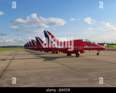 The Red Arrows parked in a line at RNAS Yeovilton, June 2012 with Somerset countryside in the background. - Stock Photo
