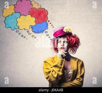 Clown woman thinking - Stock Photo