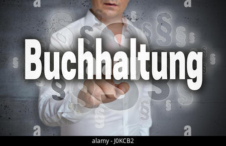 Buchhaltung (in german Accounting) touchscreen is operated by man. - Stock Photo