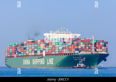 Rotterdam, the Netherlands - April 9, 2017: CSCL Venus container ship with tug boats in Rotterdam harbor - Stock Photo