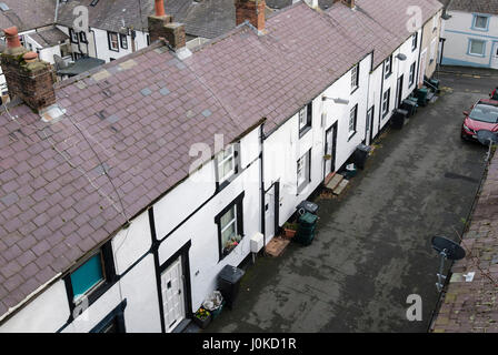 Council wheelie bins and recycling boxes in street outside a row of terraced houses with no front gardens seen from - Stock Photo
