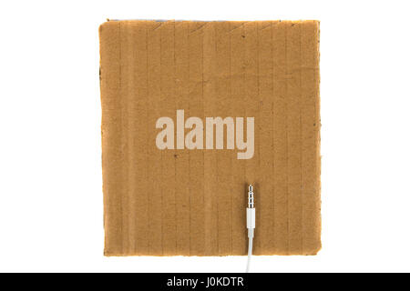 White minijack connection on cardboard background. view from above - Stock Photo