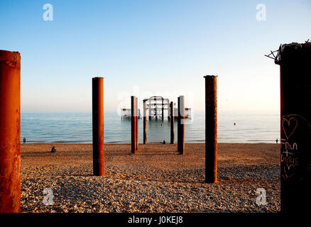 Brighton and Hove's West Pier is a famous landmark on the south coast of England, now a burnt-out rusting skeleton - Stock Photo