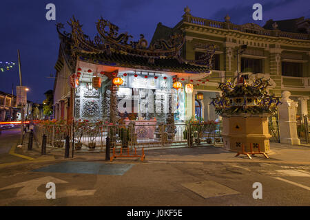 George Town, Penang - March 24, 2016: Dusk view of the Choo Chay Keong Temple adjoined to Yap Kongsi clan house, - Stock Photo