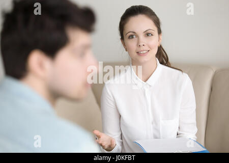 Psychological therapy, female psychotherapist cheering up depres - Stock Photo