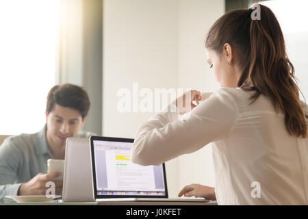 Man and woman having business lunch, coffee break while working