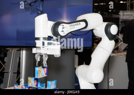 Hannover, Germany - March 22, 2017: The sensitive robot Franka from the company Franka Emika demonstrates its ability - Stock Photo