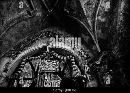 Human Bones and skulls at the Charnel House or Ossuary Kostnice ( Bone Chapel ) in Kutna Hora Czech Republic - Stock Photo