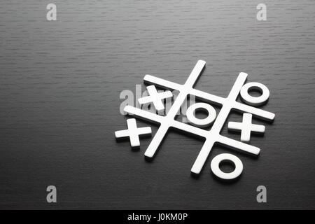 Tic Tac Toe Game on Wooden Background - Stock Photo