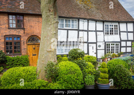 Traditional timber framed cottages on the edge of Tewkesbury, Gloucestershire UK Britain with hedges - Stock Photo