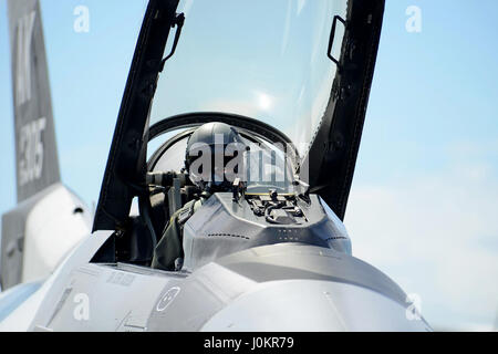 A pilot prepares for taxi in his F-16 Fighting Falcon - Stock Photo