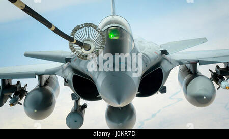 A French air force Dassault Rafale refuels from a U.S. Air Force KC-10 Extender from the 908th Expeditionary Air - Stock Photo