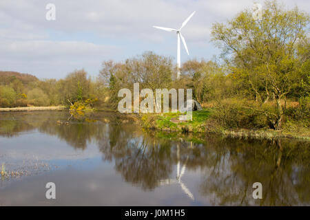 A two man tent pitched on a piece of ground beside the lake at the old lead mines workings in Conlig, County Down - Stock Photo