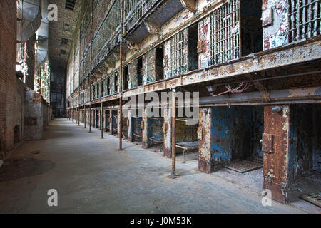 Cell block of the inside of an old prison no longer in use - Stock Photo