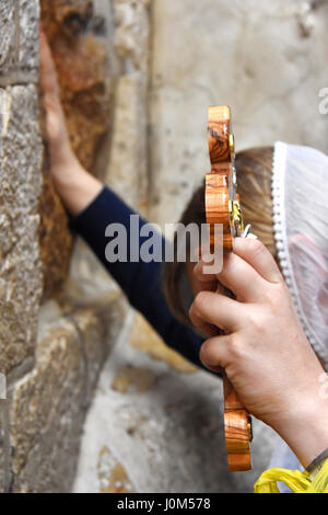 Via dolorosa pilgrim, Fifth Station in the old city, Jerusalem, Israel - Stock Photo