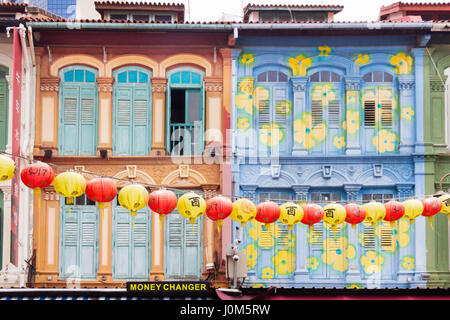 Colourful Chinese shophouses and lanterns in Pagoda street, Chinatown, Singapore - Stock Photo