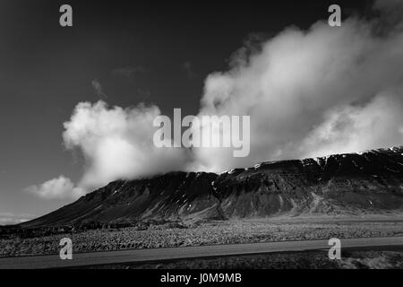 Clouds loom above a mountain in the (Snæfellsnes) Snaefellsnes peninsula, western Iceland - Stock Photo