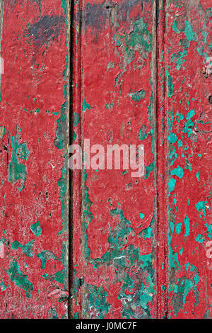 Red green chipped wooden door - Stock Photo