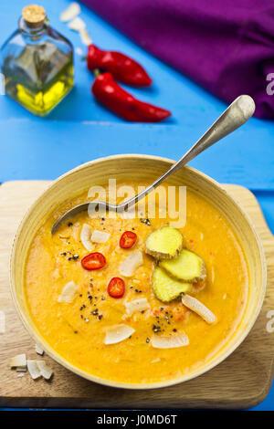 Thai red lentil, red pepper coconut cream soup - Stock Photo