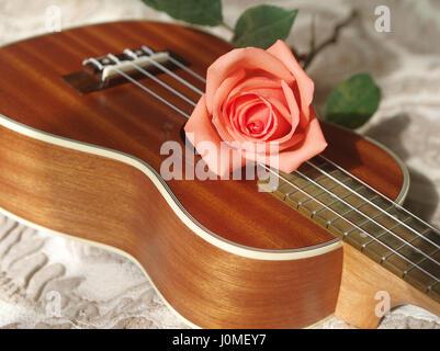 Rose on ukulele, Love, Valentines concept. - Stock Photo