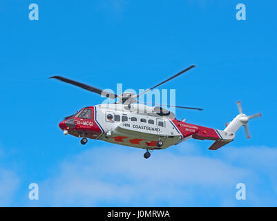 UK Coastguard Sikorsky S-92a Helicopter G-MCGI departing its Inverness Dalcross Airport base on an emergency callout. - Stock Photo