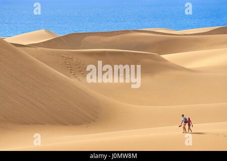 Tourists on the Maspalomas Sand Dunes National Park, Gran Canaria, Spain - Stock Photo