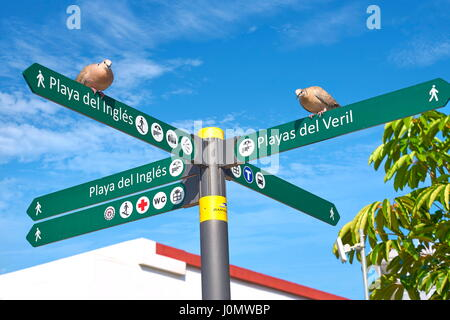 Signpost, Playa de Ingles Promenade, Gran Canaria, Spain - Stock Photo