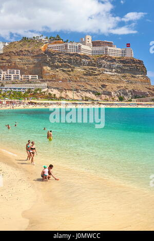 Tourists on the beach in Puerto Rico, Gran Canaria, Spain - Stock Photo