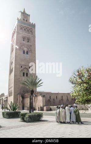 Marrakesh Koutoubia Mosque with pilgrims - Stock Photo