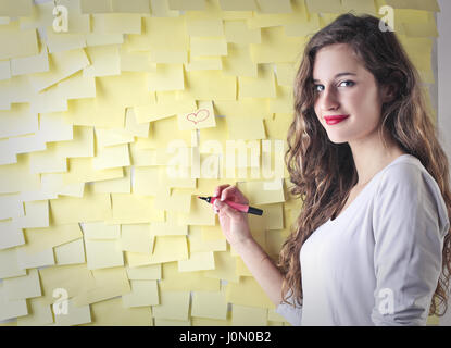 Woman with post-it wall - Stock Photo