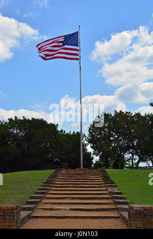 The American flag flys atop Flag Pole Hill, one of the highest points in Dallas Texas. - Stock Photo