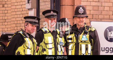 Leicester, UK. Thursday 13th April 2017.Police keeping Her Majesty Queen Elizabeth II and The Duke or Edinburgh - Stock Photo