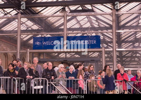 Leicester, UK. Thursday 13th April 2017.crowds wait to welcome Her Majesty Queen Elizabeth II and The Duke or Edinburgh - Stock Photo