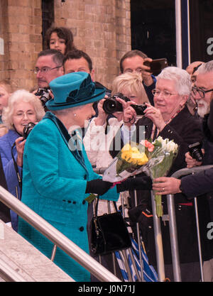 Leicester, UK. Thursday 13th April 2017. Her Majesty Queen Elizabeth II is presented with flowers as she and The - Stock Photo
