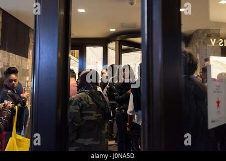 New York, USA. 14th Apr, 2017. Shoppers wait outside the Macy's Herald Square after the store temporarily closed - Stock Photo