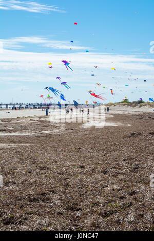 Semaphore, South Australia, Australia - April 15, 2017: Flying kites and spectators at the Adelaide International - Stock Photo