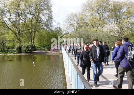 London,UK.15th Apr 2017.UK weather.Visitors to St.James park in London enjoy the afternoon sunshine. Credit: Ed - Stock Photo