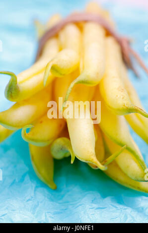 Bundle of yellow bean pods with shallow depth of field - Stock Photo