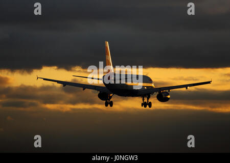 G-EUUE British Airways Airbus A320-200 cn-1782 Landing at London Heathrow airport at sunset - Stock Photo