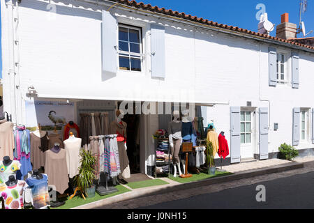 Typical street scene ladies clothes fashion shop and gifts on sale on holiday island of Ile de Re, France - Stock Photo