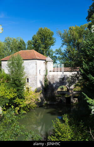 Tourists visiting picturesque traditional Moulin de Loubens, 19th Century water mill, in Gironde, France - Stock Photo