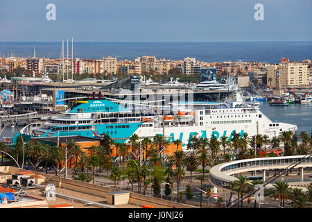 City of Barcelona cityscape with Balearia ferry moored in port at Mediterranean Sea, Catalonia, Spain - Stock Photo