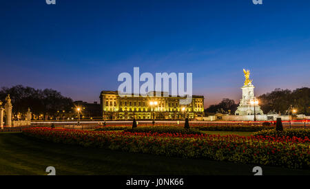 Lights at dusk and star trails over Buckingham Palace, London, UK - Stock Photo